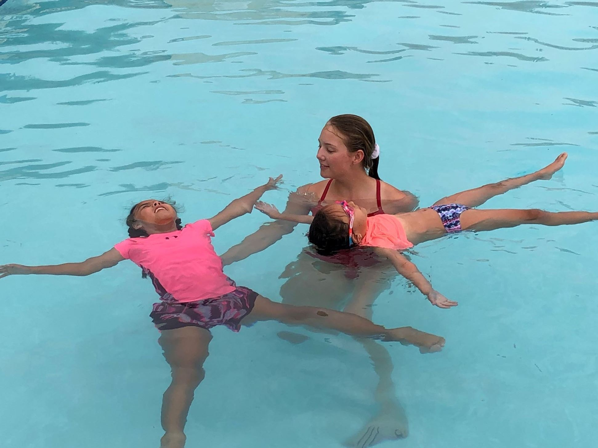 Kirsten Teaching Children to Float